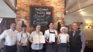 Wadworth apprentices Callum Stanley, Amanda Blackman, Jake Moore and Violetta Nagy with Wadworth retail development manager for the Pheasant John Pettit (far left) and Pheasant manager Richard Jennings (right)