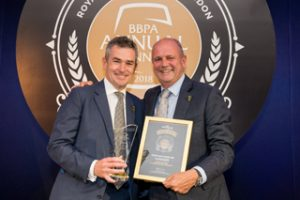 Stonegate Pub Company's Ian Payne (right) picks up the chairman's award at this year's British Beer & Pub Association (BBPA) annual awards from BBPA chairman Simon Emeny