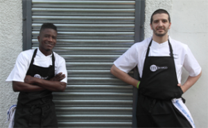 Nico Simeone (right) has gifted his debut restaurant to Modou Diagne, who was Simeone's first kitchen porter